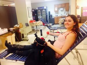 Alyssa giving blood